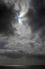 Sun peering through the clouds.