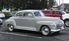 automobile(1.0), automotive exterior(1.0), 1941 ford(1.0), vehicle(1.0), mid-size car(1.0), plymouth deluxe(1.0), compact car(1.0), hot rod(1.0), antique car(1.0), sedan(1.0), classic car(1.0), vintage car(1.0), land vehicle(1.0), motor vehicle(1.0),