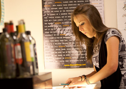Newman University student working during graphic design class