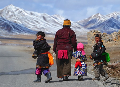 "Tibetan children in chuba ""Tibetan national garb"""