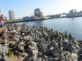 Spider-Man with some fan-made inukshuks on the edge of False Creek (during the 2010 Vancouver Olympics)