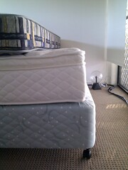 duvet cover(0.0), bed frame(0.0), furniture(0.0), bed sheet(0.0), couch(0.0), studio couch(0.0), floor(1.0), room(1.0), box-spring(1.0), bed(1.0), mattress(1.0),