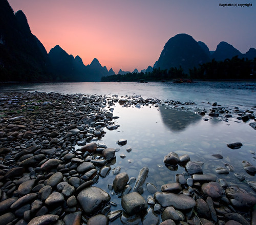 world life china travel pink light sunset people mountains color reflection heritage nature silhouette river relax flow liriver li still nikon rocks exposure view image earth stones guilin rags quality culture scene ng karst publication nationalgeographic subtle guangxi xingping d700