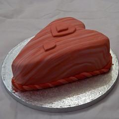 chocolate cake(0.0), baked goods(0.0), sachertorte(0.0), torte(0.0), orange(1.0), cake(1.0), buttercream(1.0), fondant(1.0), sugar paste(1.0), food(1.0), cake decorating(1.0), icing(1.0), birthday cake(1.0),