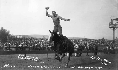 Cowboy Jason Stanley performing a riding trick at the Round-Up, Pendleton, Oregon