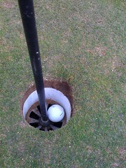 wheel(0.0), golf club(0.0), lawn game(1.0), grass(1.0), golf equipment(1.0), lawn(1.0),