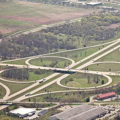 reservoir(0.0), residential area(0.0), track(0.0), race track(0.0), viaduct(0.0), highway(1.0), junction(1.0), bird's-eye view(1.0), transport(1.0), road(1.0), lane(1.0), controlled-access highway(1.0), overpass(1.0), aerial photography(1.0), infrastructure(1.0), bridge(1.0),