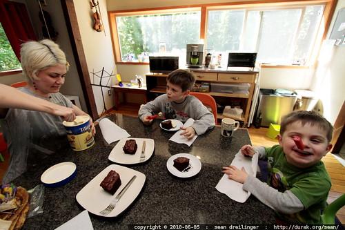 birthday girl serving her boys cake & ice cream