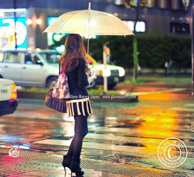Cute lady in the rain.   (Hirosaki Japan). © Glenn Waters.  Over  8,000 visits to this photo.  Thank you.