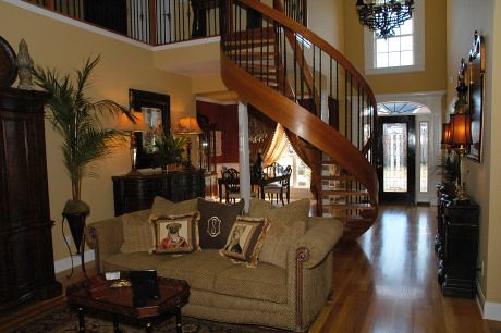 The Cherry Spiral Staircase in this beautiful home became a fast favorite with all who toured our home when it was in the Parade of Homes.  This house won Peoples Choice award.