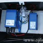 The four 12V batteries (24V) are charged and controlled by these units. The batteries are below the white cover, leaving lots of room for storage.
