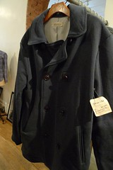 wool(0.0), leather(0.0), hood(0.0), trench coat(0.0), textile(1.0), clothing(1.0), outerwear(1.0), overcoat(1.0), jacket(1.0), coat(1.0),
