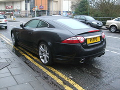 aston martin dbs(0.0), jaguar xf(0.0), automobile(1.0), jaguar(1.0), executive car(1.0), wheel(1.0), vehicle(1.0), performance car(1.0), automotive design(1.0), jaguar xk(1.0), personal luxury car(1.0), land vehicle(1.0), luxury vehicle(1.0), coupã©(1.0),