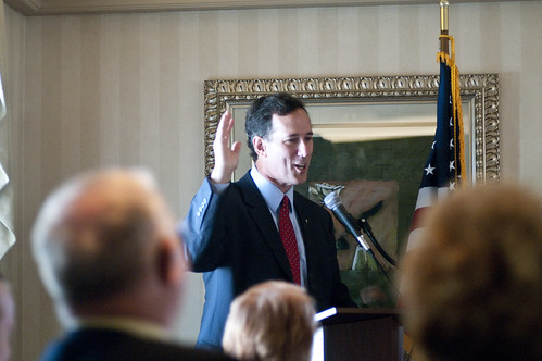 Santorum smiles while recounting a story about his father