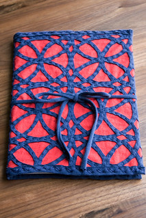 red and blue notebook cover