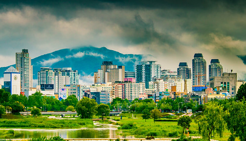 urban city daejeon korea nature landscape green sky clouds water building skyscrapper daylight