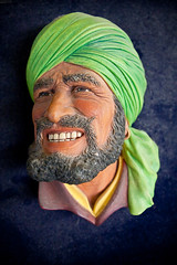 face(1.0), facial hair(1.0), dastar(1.0), clothing(1.0), yellow(1.0), head(1.0), green(1.0), portrait(1.0), headgear(1.0),