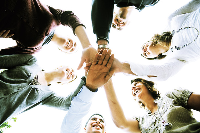 a group of people with hands joined