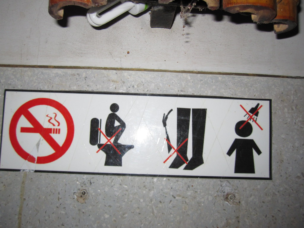 Sign in Toilet