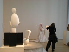 Bride amidst the Brancusi sculptures