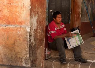 Man reading newspaper in Guatemala