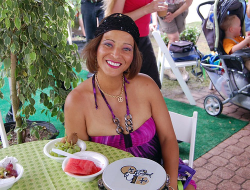 Tambourinista about town Tambourine Green stopped in at the 'OZ Hospitality Tent for some fresh fruit on Day 2.
