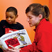 City Year corps member reading to a student