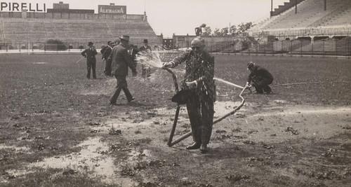 Man spraying the pitch