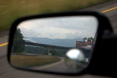 Mountains and RVs in the rearview mirror