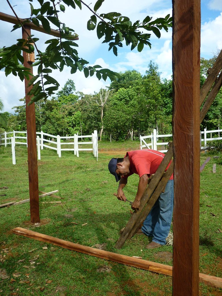 Panthera Field Technician Ever Urbina preparing lumber for the enclosure