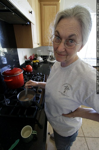 making hot chocolate for her youngest grandson