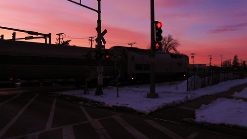 The northbound Amtrak Hiawatha crossing Chestnut Avenue at sunset. Glenview Illinois. February 2010. by Eddie from Chicago