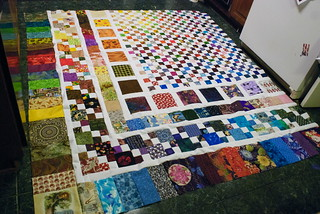 There. Done. To say I am delighted is an understatement. I am glad I took the extra time to sort the fabrics, to get a rough divide between warm and cool colors. The result isn't obvious, but it's subtly harmonious.  Also?  I just LIKE it. So there. Neener.  I'm keeping this one.  Approximate size: 80'x88'  Accompanying blog entry: domesticat.net/2010/03/these-are-few-my-favorite-things
