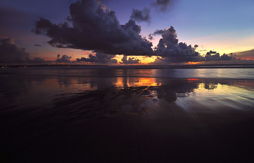 Legian beach sunset reflection