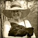 Me in a Garden Hat with a Chicken in my Arms by Lynnette Henderson