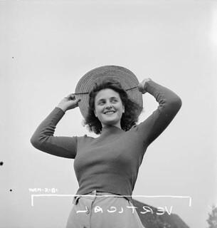 Portrait of Roberte Perry, French-Canadian female munitions worker at the Dominion Arsenals Ltd. plant. / Portrait de Roberte Perry, une ouvrière des munitions canadienne française à l'usine Dominion Arsenals Ltd