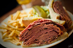 Smoked meat sandwich and fries