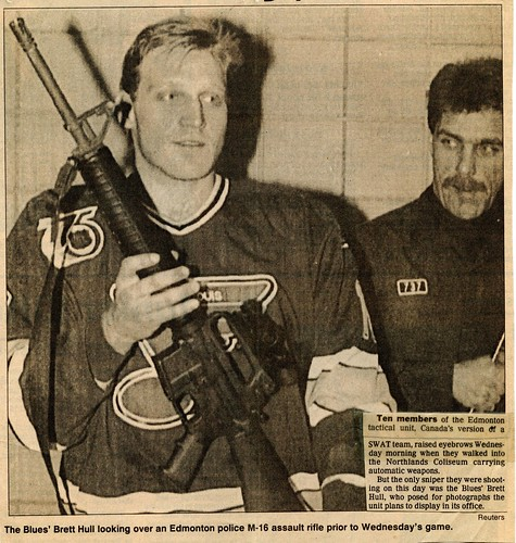 Brett Hull holding M-16 newspaper clipping_img605