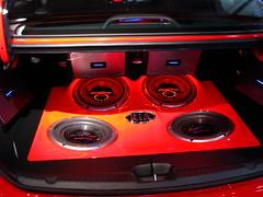 automotive exterior(0.0), family car(0.0), wheel(0.0), steering wheel(0.0), bumper(0.0), engine(0.0), vehicle audio(1.0), automobile(1.0), red(1.0), luxury vehicle(1.0),