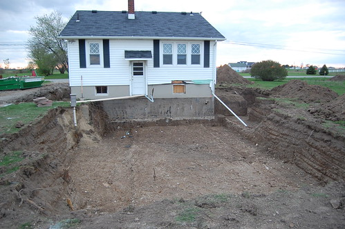 Diy house addition building a house from the ground up for Digging foundation for house