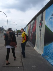 Ru our tour guide in front of the Berlin wall