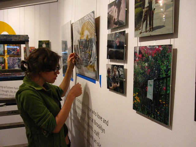 """""""Is it level?"""" Christine makes some minor adjustments to one of the photo walls."""