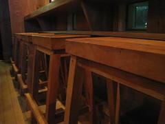 countertop(0.0), table(0.0), beam(0.0), basement(0.0), cabinetry(0.0), floor(1.0), furniture(1.0), wood(1.0), room(1.0), wood stain(1.0), wood flooring(1.0), hardwood(1.0), flooring(1.0),