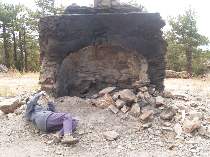Vicki taking a photo up into the giant fireplace on the Santa Rosa Mountain summit