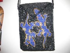 coin purse(0.0), tote bag(0.0), brand(0.0), bag(1.0), art(1.0), pattern(1.0), textile(1.0), handbag(1.0), design(1.0), bling-bling(1.0), blue(1.0),