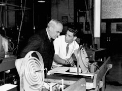 C.D. Howe watches a scientist test the curve of a lens, Instruments Division, Canadian Arsenals Ltd. / C.D. Howe observe un scientifique qui v�rifie la courbure d?une lentille, Division des instruments, Arsenaux canadiens Lt�e