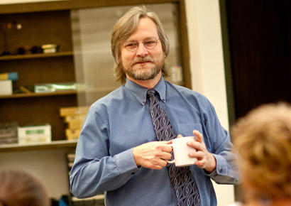 Professor David Shubert teaches during a physics class