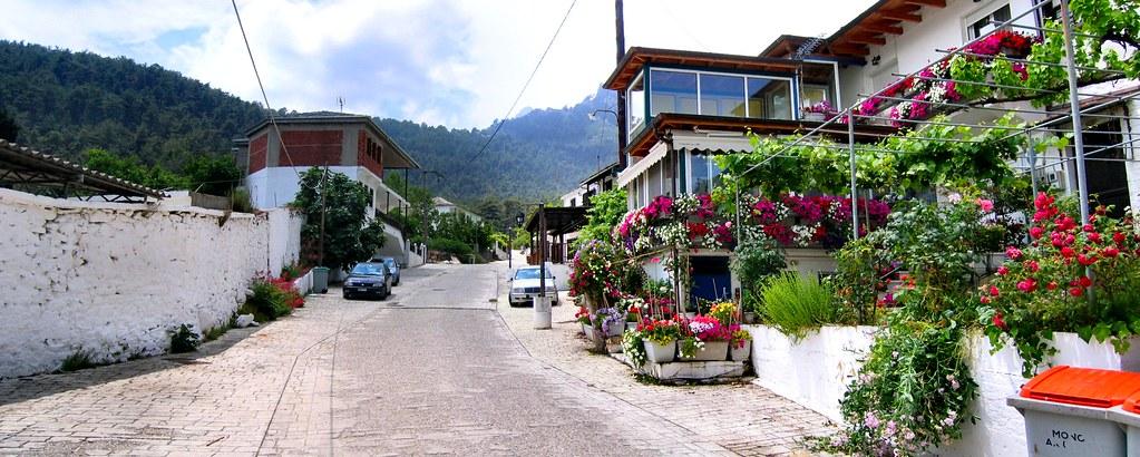 THASSOS GREECE. A STREET IN PANAGIA LEADING TO THE MOUNTAIN.