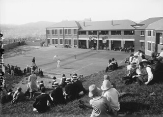 People watching an exhibition game at the opening of the tennis courts at Wellington East Girls College, 3 Nov 1926