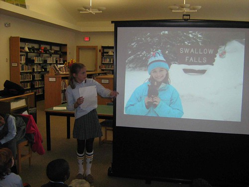 Bullis 3rd grader giving a presentation about her adventures with her Buddy